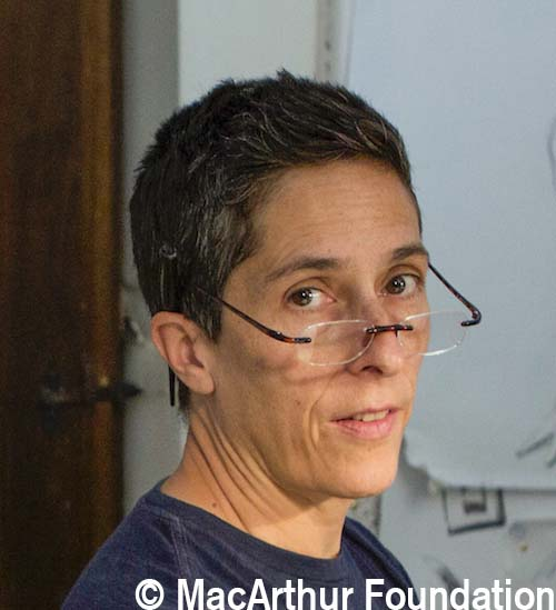 U.S. cartoonist Alison Bechdel portrayed as she works in her studio at the castle of Civitella Ranieri, central Italy, Tuesday, Sept. 2, 2014.